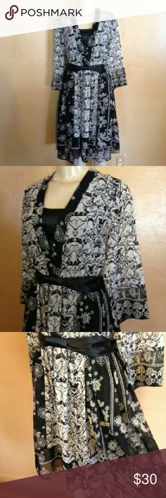 Essentials by ABS dress Beautiful black and white flared sheer dress with floral and filigree patterns. Dress has a back zipper for closure and is fully lined . Has a satin faux cami and sash bow. Essentials by ABS  Dresses
