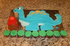 A long time customer of mine came to me looking for a dinosaur cupcake cake. I've had the pleasure of making her daughter many cakes in the past, including a fish, barnyard, and Olaf! Most of which were made out of cupcakes! But this time… the order was for her little boy who was turning …