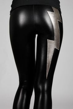 Bestseller since their introduction F/W 2008. These shiny black faux leather lightning bolt leggings with low waist are Rock 'n' Roll. The high
