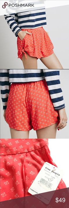 NWT Free People Side Tie Shorts A new with tags side tie shorts in coral color. Features elastic waist band.  In Size extra small. Free People Shorts