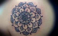 Crisp and clear black ink lines give this spiritual flower of life ...