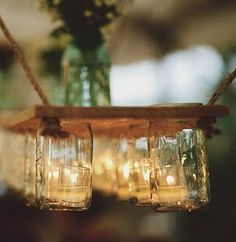 Outdoor chandelier - mason jars on a wooden hanging plank