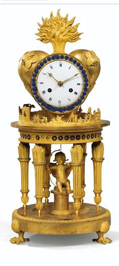 A GILT-BRONZE AND ENAMELLED MANTEL CLOCK, RESTAURATION, CIRCA 1820
