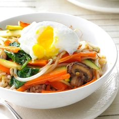 Stir-Fry Rice Bowl Recipe -My meatless version of Korean <i>bibimbap</i> is tasty, pretty and easy to tweak for different spice levels. Koreans usually eat this rice dish with some beef, but I decided to top it with an egg. —Devon Delaney, Westport, Connecticut