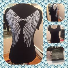 Black sleeveless t shirt with tie shoulder detail Black sleeveless t shirt with white wings on back.  Tie detail at shoulders.  Size small.  No trades.  No other websites.  Use offer option to ask fro price drop. Hot Topic Tops Tees - Short Sleeve