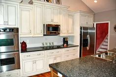 Open Floor Plan Kitchen | cabinets cherry floors inground pool two bay garage and large yard