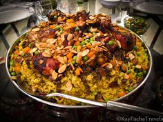 Oozie -- Jordanian dish with lamb, ground beef, spices, rice, chicken, peas+carrots, nuts..