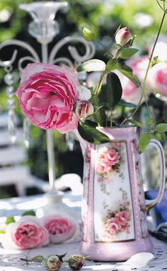 Beautiful rose pitcher and roses