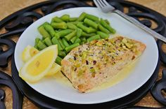 Pistachio Encrusted Salmon W/Lemon Sauce.  You could also use Cod  http://www.foodnetwork.com/food/cda/recipe_print/0,1946,FOOD_9936_497847_RECIPE-PRINT-FULL-PAGE-FORMATTER,00.html