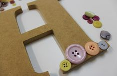 Button Art is so easy to do and looks amazing when finished. Read our blog to see how easy it is!
