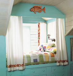 When I was a child I would have loved this bed...okay...maybe not the fish. Photo by Dana Gallagher, Cottage Living