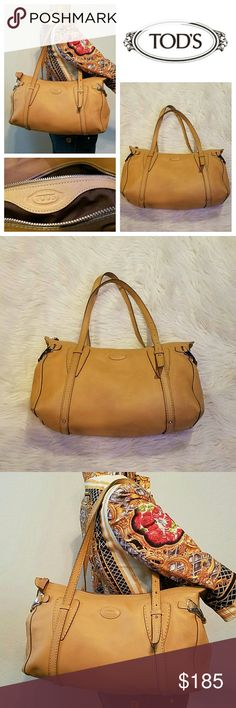 $1650 Large TOD'S Camel Leather Satchel Bag Beautiful bag by Tod's! Perfect for everyday use! Large Satchel with double straps. Top zippered opening, Tods logo stamped on front, unique silver hardware on sides, one inside zippered pocket. Pre-owned, one ink line on back, minor darkening, no rips, tears, holes, inside clean, all stutching strong, corners good. Authentic, Made in Italy, Stamped Serial numbers. Retailed for  $1650 Tod's Bags