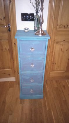 Upcycled tall drawer unit crystal knobs to finish..