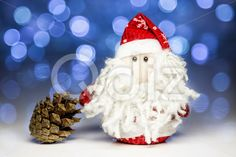 Qdiz Stock Photos | Santa Claus with pine cone,  #background #beard #celebration #Christmas #Claus #Clause #closeup #cone #decoration #doll #eve #Father #figure #frost #fun #funny #greeting #holiday #lights #little #Merry #new #pine #pinecone #red #Santa #small #toy #traditional #white #x-mas #xmas #year