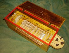 Musical instruments build from discarded materials -- hurdy gurdy