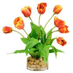 Faux tulip arrangement in glass vase.   Product: Faux floral arrangementConstruction Material: Silk, rocks, and glass