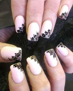 Lace with heart symbols, painted at the corner of the light pink nails.