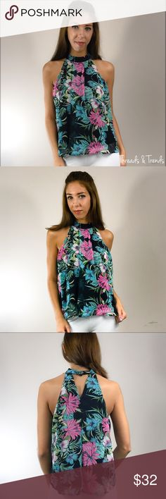 The Miya Halter Blouse The Miya Halter Blouse, featuring the choker neckline with a tropics floral print in a stunning array of colors. Navy's, greens and pinks. Pullover with button closure at neckline. Pair with denim, skirts, trousers or shorts. Finish the look with a floppy straw hat. Outer shell fabric made of chiffon, inner shell polyester. Soft, silky and flowing. Size S, M, L                                   Small  Bust 42 Length 25.5  Medium  Bust 44 Length 26  Large  Bust 46…