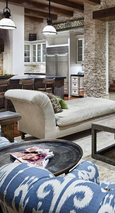 interior stone column - intersects with large wooden beams, which is nice. This gives a rustic modern look that can change a bit with the interior furnishings
