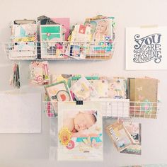 """""""This wall in my studio makes me happy >> baskets for storing some of my mini albums, a layout I made for the cover of Creating Keepsakes magazine a couple years back, love letters from my kiddos and a print gifted to me by Studio Calico (created by @thewellkeptthing)"""" (Follow Creative Team member Maggie Holmes at @maggiehdesign) #SCguest #Padgram"""