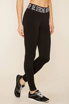 """A pair of seamless knit leggings with moisture management and a repeated """"Be Strong. Never Stop."""" graphic along the waist."""