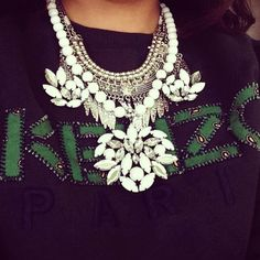 Image via Thank God I'm a Girl. Statement necklace and Kenzo sweater. Details in street style.