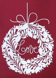 white wreath papercut