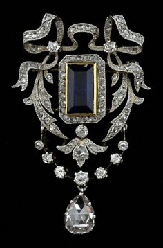 An Edwardian sapphire diamond brooch. Set to the centre with a step-cut sapphire and pear form rose-cut diamond drop, the remainder set with rose and old European-cut diamonds, mounted in platinum. Length 4.3 cm. #Edwardian #brooch