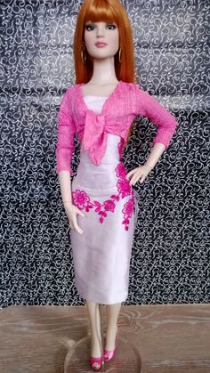 Lilac silk dress with dark pink appliqued hand stitched lace worn, with pink tie front pink cardigan...