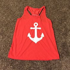 Adorable anchor bow tie tank top Adorable anchor bow tie tank top. Color is a coral orange pink as shown in photos. White anchor on the front and a blue bow on the back. Size small. Tops Tank Tops