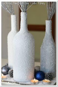 Re-use and recycle! Those old Kahlua bottles will come in handy as beautiful white centerpieces coated in Epsom salt.