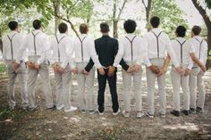 OK RIGHT? We've seen a lot of funny groomsmen photos, but this sets a new standard for awesomeness.