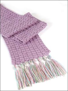 Sugar Plum Scarf & Ski Band - This pale purple and pastel scarf is a beginning pattern. A simple winter treat for your snow bunny! Freepatterns.com
