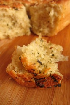 Garlic Pull Apart Bread (not vegan) : spread garlic butter on dough, roll up, separate into buns and place in pan