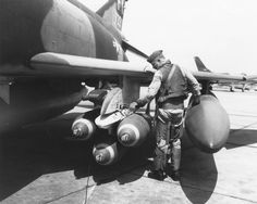 fcba:  Colonel Robin Olds checks the ordnance on his F-4 Phantom II prior to a mission. (USAF photo via the National Museum of the USAF)