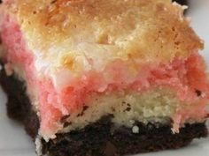 A layer of chocolate cake mix, vanilla cake mix, and strawberry cake mix are separated by sweetened coconut and topped with sweetened milk to make these bars.
