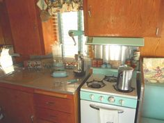 1962 Shasta Trailer with seafoam Princess gas stove and matching vent hood