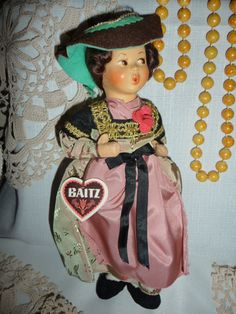 This is a stunning Baitz doll from the 1960s, she is called a whistling doll due to her lovely pouty pose. She is in great condition and would be a great example for a collection.