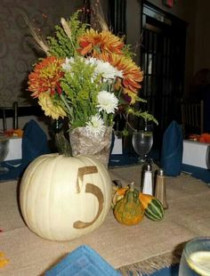 Our wedding centerpieces: Birch vase, fall flowers, white pumpkin, gourds, and gold burlap