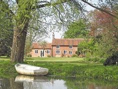 Tucked away down a quiet country lane, nestling by the church and virtually surrounded by its owner's meadows English Country Cottages, Country Homes, Norfolk Holiday, Beautiful Places, Farmhouse, Exterior, Mansions, House Styles, Brittany