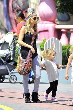 Nicole Richie wearing Minnetonka Tramper Lace Up booties in Black Simone Camille Handmade Bag Jet by John Eshaya Bolt Skinny Jeans in Grey