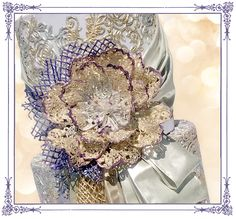 * The Gold & Purple experience ** Many Crystal Candy products were used in the creation of this cake: *** Crystal Lace Signature Blend for all the edible lace Go to our YouTube video to see how to make your own lace with ease:https://www.youtube.com/watch?v=4mZervGk-ZE *** Edible FabricArt for all the drapes *** Angels Aura Pearlescent Lustre for coloring the fondant *** Glitterati Gold & Mercury Diamond lustre for the edible lace *** Bastille Vivid Diamond lustre for the lace at the base of…