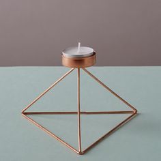 Geometric Triangle Candle Holder. See more Copper inspirations at http://www.brabbu.com/en/inspiration-and-ideas/ #CopperLighting