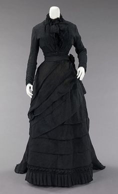 Mourning ensemble   Date: ca. 1870  Culture: American  Medium: silk  Dimensions: Length at CB (a): 18 1/2 in. (47 cm) Length at CB (b): 56 in. (142.2 cm) Other (c): 32 in. (81.3 cm)  Credit Line: Brooklyn Museum Costume Collection at The Metropolitan Museum of Art, Gift of the Brooklyn Museum, 2009; Gift of Martha Woodward Weber, 1930  Accession Number: 2009.300.633a–c