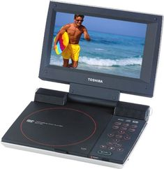 Watch movies on the go with this sleek Toshiba 7 portable DVD player. The 7 widescreen TFT LCD is perfect for viewing standard, letterbox or anamorphic DVD mo Shower Speaker, Dvd Vcr, Voice Recorder, Tv Videos, Cool Things To Buy, Dvd Players, Audio, Electronics, Digital