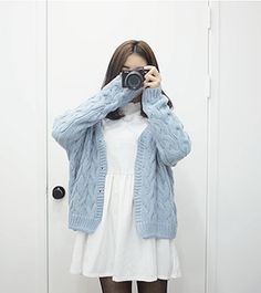 pastel blue knit cardigan with sleeves too long, loose white dress