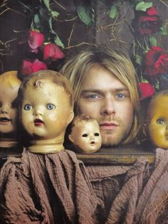 An outtake from a photo shoot Kurt Cobain did with Rolling Stone magazine. The photo shoot was planned per Kurt's request and the concept of the photographs were designed by Kurt.     He loved this photo and kept it in his personal collection.
