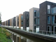 Blocked at home in the Netherlands is part of Brick architecture - Unusual Buildings, Interesting Buildings, Modern Buildings, Brick Architecture, Residential Architecture, Leiden, Casa Patio, Townhouse Designs, Brick Facade