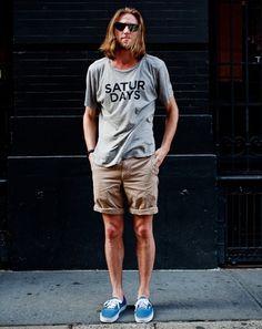 Shop this look on Lookastic: lookastic.com/...  Grey Print Crew-neck T-shirt  Beige Shorts  Blue Plimsolls  Black Sunglasses