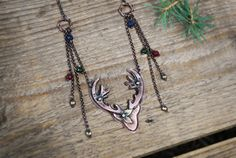Copper deer , Spirit of the nature, necklace with small jade beads. The necklace is oxidized and polished. -length of the chain approximately 40 cm (15.75 in) -size of the pendant approximately 5 cm (1.97 in) If you have and additional questions, feel free to contact me, Ill be more